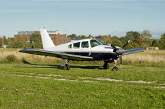 Small plane with building at background Stock Image