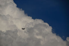 Small plane and clouds Stock Photos