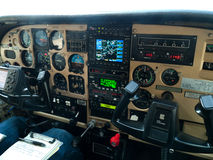 Small plane cockpit packed with instruments. A small plane cockpit with all the electronic equipment for navigation and safety Stock Photos