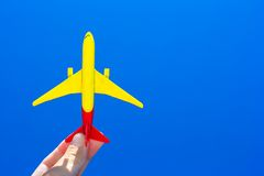 Small plane in female hand on background of blue Stock Photography