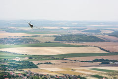 Small plane flies over the large country Stock Photo
