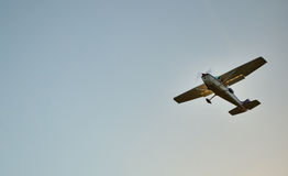 Small Plane Flying with blue sky background royalty free stock photography
