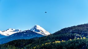 Small plane flying over Green Lake neat Whistler British Columbia Royalty Free Stock Image