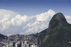 Small plane flying over Rio De Janeiro Royalty Free Stock Images