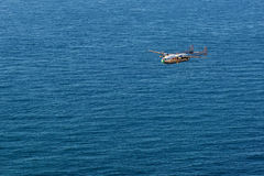 Small plane flying over the sea Royalty Free Stock Images