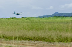 Small Plane Grass Landing Royalty Free Stock Photos