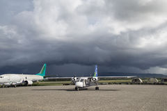 Small plane at Honiara airport, Solomon Islands. Honiara, Solomon Islands - May 27, 2015: Small propeller plane parked at the airport Stock Images