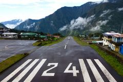 Small plane landing at the 'Tenzing-Hillary ' Airport in Lukla, Everest Base Camp trek, Nepal stock images