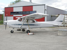 Small plane near hangar stock image