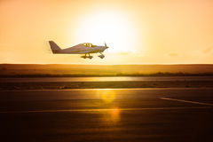 Small plane on the runway. Background of sunrise royalty free stock images