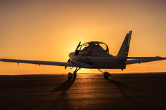 Small plane on the runway Stock Photos