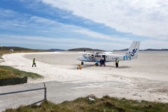 Small plane on the sandy runway of Barra Airport Stock Photography