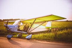 Small plane in the sky and on the field. Vintage photo. Even Royalty Free Stock Photos