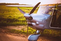 Small plane in the sky and on the field. Vintage photo. Even Royalty Free Stock Photo