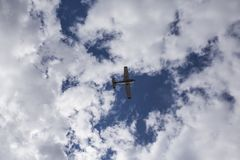 The small plane in the sky stock photography