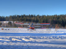Small plane on snowy field. A small airplane on a snowy field ready to take off royalty free stock image