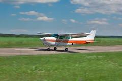 Small plane takeoff stock photos