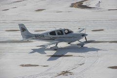 Small plane taxiing in the snow during winter Stock Photo