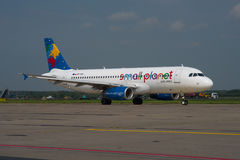 Small Planet Airlines Poland Airbus A320. KATOWICE, POLAND - AUGUST 2016 Small Planet Airlines Poland Airbus A320-232, SP-HAG, cn 1723 taxiing to the runway for Stock Images