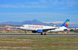 Small Planet Budget Airline With A Backdrop Of Snow Stock Image