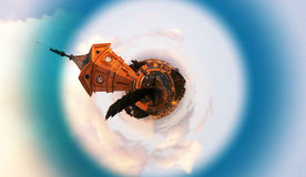 Small planet with a clock tower Stock Image