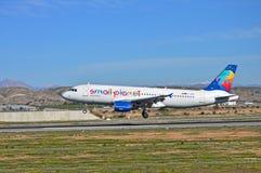 Small Planet Passenger Plane Stock Photo