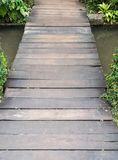 Small plank bridge over the canal. Royalty Free Stock Photos