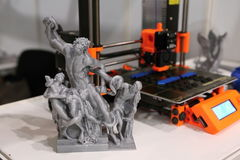 Small plastic statuette with the 3d printer royalty free stock images