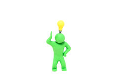 Small plasticine puppet with a electric bulb over the head Royalty Free Stock Image
