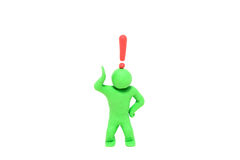 Small plasticine puppet with a exclamation mark over the head Stock Photos