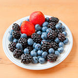 Small plate with fresh summer berries - strawberry, blueberry an Stock Images