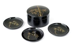 Small plates. Isolated black plates, decorated with japanese motives Royalty Free Stock Image