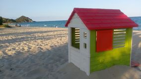 Small play house on quiet beach stock photo