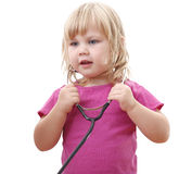 Small playful girl with stethoscope Royalty Free Stock Images