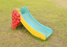Small playground slider. In the garden Royalty Free Stock Photos