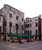 Small plaza with building and a nice restaurant. Small plaza with buildings and a nice restaurant in Venice, Italy stock photos