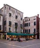 A restaurant on a small plaza with building in Venice Italy. Small plaza with buildings and a nice restaurant in Venice, Italy stock image