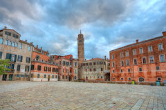 Small plaza among houses. Venice, Italy. Royalty Free Stock Image