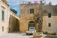 Small plaza in Mdina, Malta. Small plaza with traditional houses and parked retro pickup in Mdina, Malta Royalty Free Stock Photos
