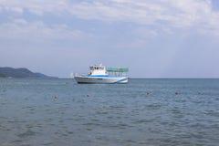 Small pleasure boat Antey near the coast in Lazarevskoe, Sochi Royalty Free Stock Images
