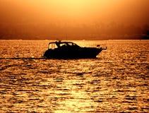 Small Pleasure Boat Craft Sailing at Sea at Sunset stock image