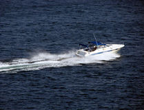 Small Pleasure Boat Craft Speeding on Water. Small Pleasure motor boat craft speeding on water Stock Photos