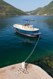 Small pleasure boat floats moored in Perast Stock Photo