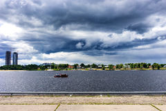 Small pleasure boat with tourists before the storm Royalty Free Stock Images