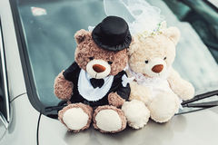 Small plush bears on a wedding. Decoration on the car hood Stock Photography