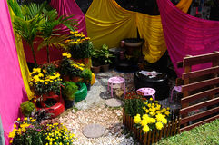 Small pocket garden made from mix of recycle material and flower. PUTRAJAYA, MALAYSIA -MAY 30, 2016: Small pocket garden made from mix of recycle material and Royalty Free Stock Images