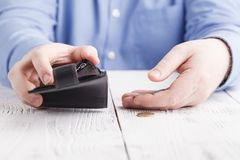 Small pocket money and empty wallet, crisis concept Royalty Free Stock Photography
