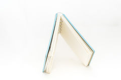 Small pocket notebook on  background Royalty Free Stock Photos