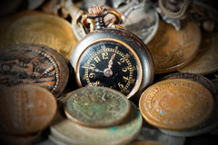 Small Pocket Watch with Old Coins Stock Photos