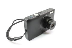 Small point and shoot digital camera. Small, black, point and shoot digital camera displayed on a white background Stock Image